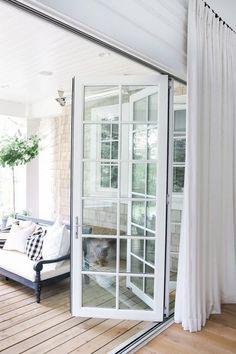 White folding doors   Outdoor Living   http://monikahibbs.com