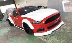 Liberty Walk Working on Widebody Ford Mustang : Yes folks the moment has finally come for a Ford Mustang Liberty Walk body kit. We have no idea who decided the 'Stang wasn't wide enough but Kato Wataru and his crew are leaving no cult car untouched. 8 pho