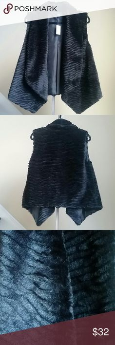 🆕Lisa International Faux Fur Vest Beautiful black faux fur vest by Lisa International. Lined.  Shell and lining 100% Polyester. 🚨Price Firm!🚨 Lisa International Jackets & Coats Vests