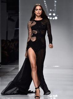 Flawless: Irina oozed glam in the sleeved gown with delicate sheer panelling that fitted her like a glove and framed her hour-glass figure beautifully