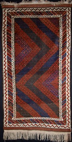 ANTIQUE BALUCH RUG, BOLD MUSHWANI LATTICE DESIGN, CIRCA 1900 Size: 5ft 3in x 2ft 10in (160 x 88cm).  Antique Baluch rug from Western Afghanistan of small size with a bold Mushwani lattice design giving a very striking visual effect.