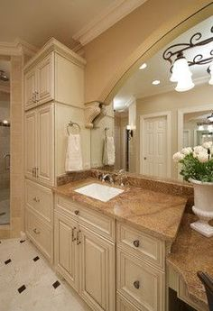 343962490261986200 Old World Elegance traditional. Marble, granite, limestone, glass tiles, and custom glazed cabinetry all in soft earth tones