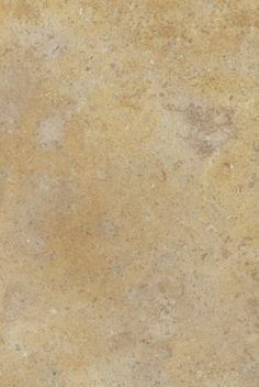 A color range from sandy brown to mustard yellow dotted with dark copper minerals and a hint of salmon. Low color variation.