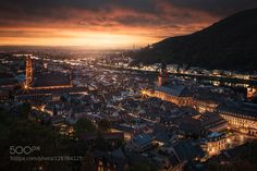 Fit for a King Heidelberg Germany. Cityscape fit for a king. I shot this on top of the ruins of Castle Heidelberg. This is the first place I visited eight years ago when I moved to Germany. I fell in love with this town and knew one day I had to go back to capture this beautiful cityscape. Right before sunset a storm rolled in and thankfully it broke for a few minutes and I was able to capture this shot.