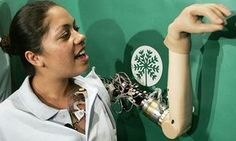 Claudia Mitchell demonstrates the functionality of her 'thought-controlled bionic arm' during a news conference in Washington DC