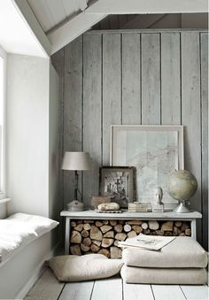 Rustic and calming room with sunny sitting/reading window nook - what a simple way to store/stack firewood! Would be great in any cabin or cottage - curl up on a rainy day with a book and coffee. Love the map and globe accents