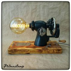 Handmade steampunk lamp by Russian designer Old Sewing Machine Table, Antique Sewing Machines, Lampe Steampunk, Steam Punk, Black Bathroom Decor, Classic House Exterior, Luminaire Vintage, Glass Insulators, Old Lamps