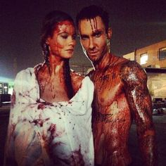 Pin for Later: The Sweetest and Silliest Celebrity Candids From 2014  Behati Prinsloo and Adam Levine posed for the camera while covered in fake blood.