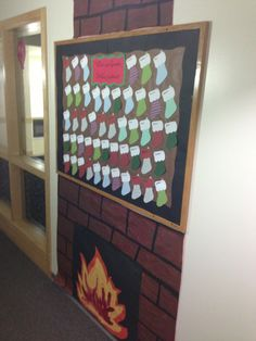 Holiday fireplace bulletin board with residents stockings