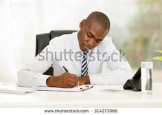 busy african american businessman working in modern office