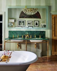 A charming country retreat, the master bathroom of Kate Moss's #cotswolds home features a range of classic pieces from Drummonds. Our Double Lowther vanity with striking Verde Guatemala marble forms a focal point of the room, sitting perfectly against the hand-painted striped walls and warm oak floor. Kate Moss, Lustre Antique, Victorian Bath, Cast Iron Bathtub, Classic Baths, Vanity Basin, Bath Shower Mixer, Striped Walls, Clawfoot Bathtub
