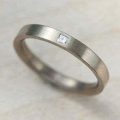 Women's eco-friendly engagement ring, flat band ring with flush-set conflict-free square princess-cut diamond for modern, simple yet unique, elegant engagement ring.