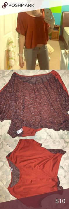 Dark orange, with dark colored back loose shirt Dark orange top, fits loose. Darker multi colored back. Size small. Worn twice. Great condition Charlotte Russe Tops Blouses