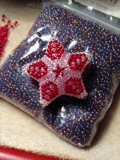 3D geometric star. Peyote, seed beads size 11, red and iridescent  clear. Christmas decoration.