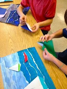 torn paper seascapes. perhaps the boats are made by colouring oil pastel resists and painting with tempera cakes. then then can be cut out and glued on!