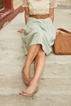 Lace shirt, belted mint polka dot skirt.