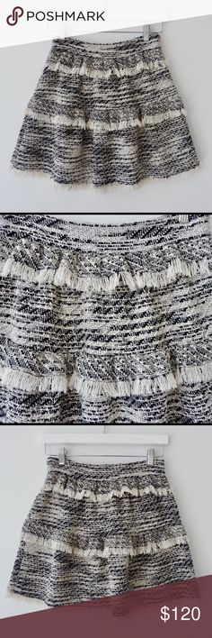 IRO Jorgina Skirt Good condition, no signs of wear . Size 34 ( 2 US)  The Jorgina Skirt from IRO is a tweed style skirt with a fitted waistband and twin layer skirt. It features a side zip and raw edge fringing details.  48 Cotton 28 Polyester 20 Viscose 20 Acrylic 4 Other IRO Skirts Mini