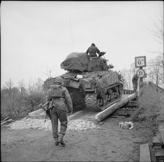 BRITISH ARMY NORTH-WEST EUROPE 1944-45 (BU 3141)   A Sherman tank of the Royal Scots Greys, 7th Armoured Division, crossing the Dortmund-Ems Canal, 4 April 1945.