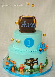 Honey pot smash cake on top of Winnie the Pooh cake