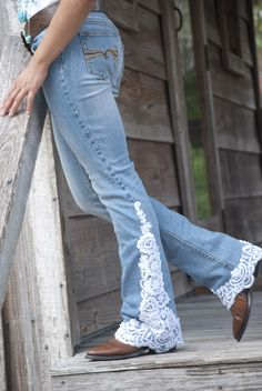 www.shiftjeans.com Size 2-16 Oyster colored lace, with beads and sequins, trim the hem and outer leg of a great fitting jean. The lace applique is higher on one side than the other. Rear pockets have lace trim. All jeans are low to mid rise and boot cut. Special requests are welcome, just email us. Denims and laces will vary.