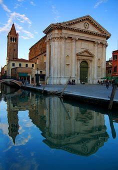 St. Barnaba church reflected in canal, Venice, Italy.