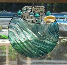 Handmade Round Stained Glass Suncatcher with glass bubbles and pearlized Turbo shell. $38.00, via Etsy.