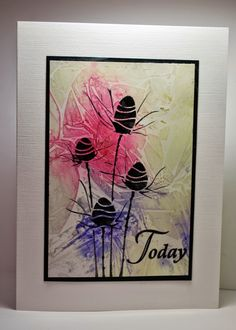 By Eileen Godwin.  I would create a background using Brusho powders, water, and plastic wrap. Lay Sweet Poppy stencil on piece and ink through it with VersaMark; lift stencil; heat emboss with black powder. Add sentiment, black mat, and white card base.