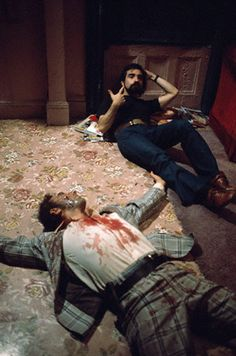 "Martin Scorsese directing the scene of Travis Bickle's killing spree in ""Taxi Driver"", demonstrating how he wants DeNiro to repeatedly pull the trigger on the empty gun pressed against his head trying to suicide after the bloodbath."