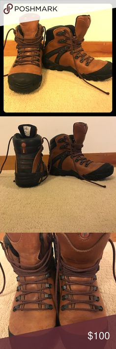 Merrell leather hiking boots (Vibram) Brown leather. Above ankle. Vibram, gore-tex. Minimal wear on tread, some water spots present on leather Merrell Shoes Winter & Rain Boots