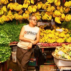 B-A-N-A-N-A-S: Just love how the banana salesman went the extra mile to present his bananas by hanging them from the ceiling. Head over to our blog to get a glimpse of the Real Mauritius and its beautiful, colorful and friendly people in a stunning and honest photo essay.