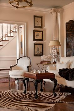 love this charming room with traditional furniture and a zebra rug