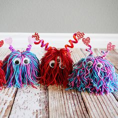 Yarn Love Bugs - From classroom activities to handmade Valentines to play at home kids will love to make these 18 super cute DIY craft projects. Each of these Valentine crafts is easy enough for most ages to enjoy making. #valentinesday #kidscrafts #diyvalentines #crafts #valentine #valentinecrafts #valentinesdaycrafts #craftsforkids