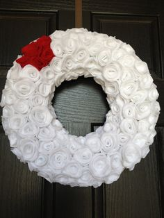 Rosette Christmas Wreath. Like the idea, would prefer all white with a cute bow in silver or black..