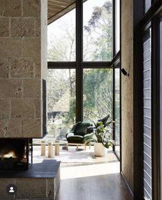 Wallington House by Clare Cousin Architects photo by Sharyn Cairns  The earthy tones of natural materials mix beautifully with the three sided slow combustion, open fire. Such a relaxing, calm space. Beautiful Interiors, Beautiful Homes, Clare Cousins, Limestone Block, Interior Architecture, Interior Design, Australian Architecture, Living Room With Fireplace, Wall Cladding
