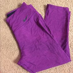 Purple Nike Dri-fit yoga capris Worn 2x! Size medium purple Nike Dri-fit leggings. Nike Pants Leggings