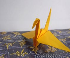 The traditional origami crane design has been adapted to fit many projects, ranging from clever origami crane envelopes to festive origami crane party favor boxes.