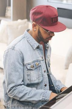 Lewis Hamilton wearing Beastin x Garfield Letter G Pin, Beastin x Garfield Denim Jacket, BSTN Box Logo Snapback, Beastin Courtesy BSTN Pin