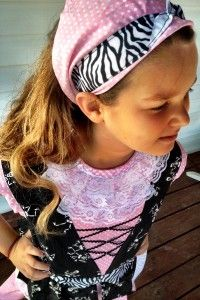 Girls pirate costume bandana to match the pink dress and zebra ribbon around bodice of her pirate costume. Inspired by Izzy from Disney's Jake & the Never Land Pirates!