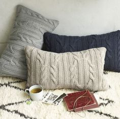 Repurpose your old sweaters to make soft, comfy pillows to place on your bed or sofa.