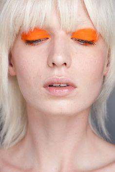 Orange eye shadow.