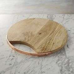 Free Shipping.  Shop Beck Serving Board.  Warm, beautiful copper fashions a sleek handle that skims the rim of gorgeously grained mango wood board.