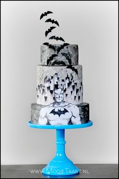 "Black & white Batman cake. I like the way the bats ""fly"" off the cake."