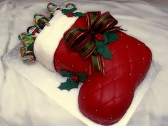 Christmas Stocking - My first christmas cake :) I am very happy with the result, they wanted a wow effect for  children and for grownups. Vanilla cake and vanilla buttercream covered with fondant. Toys are fondant as well and real candy cannes. TFL