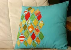 Stashbuster pillow.  This links to several stashbuster crafts, but I love the look of this pillow and would probably do a coordinating set with different shapes.