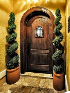 """This custom 40"""" X 90"""" Radius Top V-Groove Raised Panel Door and Jamb was built out of Spanish Cedar and has a """"Speak-Easy"""" door over the window."""