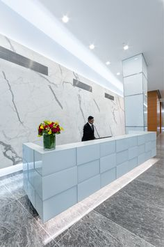 A lobby #renovation of the US Social Security Administration building in downtown #Manhattan uses #ArtisticTile's thin porcelain slab in Statuary to create a sleek #contemporary space. The large format and easy handling of these slabs makes them perfect for projects where turnaround time is key, and a polished, seamless look is desired.
