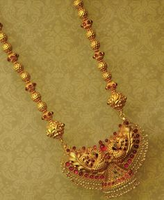 Indian Jewellery and Clothing: Beautifully crafted gold temple jewellery studded with rubies and emeralds from Anmol Jewellers..