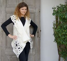 Unique felted vest with great fancy collar, natural white and ecru. Decorated with beautiful gold leaves , natural silk yarn, wool curls and ramie