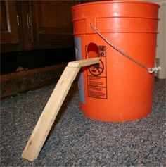 Homemade bulk mouse trap.Horrific but sometimes needed : (