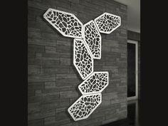 Sistema di pannelli modulari componibili a parete in metallo traforato.  Modular panel system in laser-cut steel plate.
